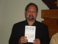 The author poses with a just-off-the-presses copy of his work.